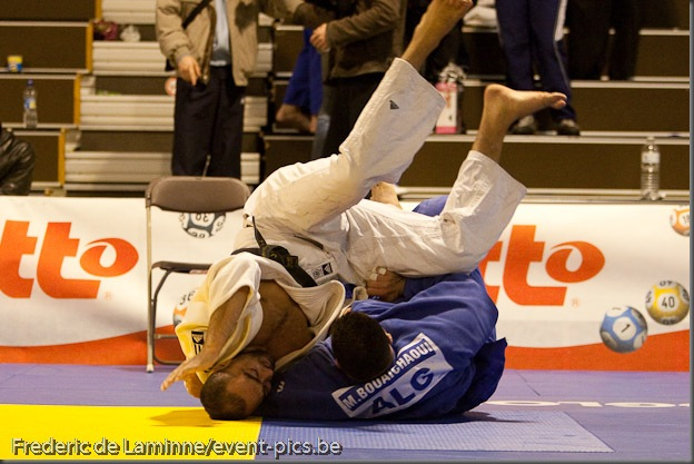 Visé - January 30 : Mohamed BOUAICHAOUI (blue) from Algeria compete with  Jallal BENALLA from France in the final match of Men's +100 Kg during the Judo Open International 2010 in Visé, Belgium. BOUAICHAOUI won the match.