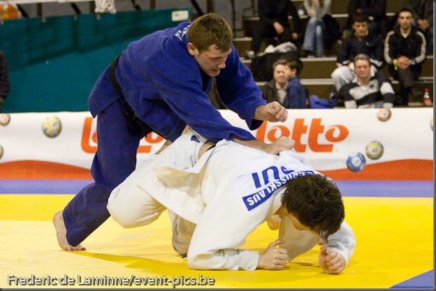Visé - January 31 : Joachim BOTTIEAU (blue) from Belgium compete with Ciril GROSSKLAUSS from Switzerland in the match for the 3rd place of Men's -81 Kg during the Judo Open International 2010 in Visé, Belgium. BOTTIEAU won the match