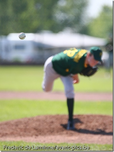 May 23, 2010; Namur, Belgium. Belgian Baseball Championship (1BB) : match between the Namur Angels (white) and the Merksem Greys. A Greys fastball is caught mid-air and appears to be frozen. Greys defeated the Angels 19-2.