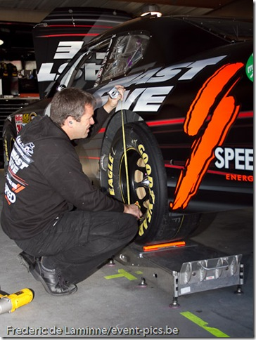 A mechanic check the settings of Robby Gordon's car before the Goody's Fast Relief 500 at Martinsville