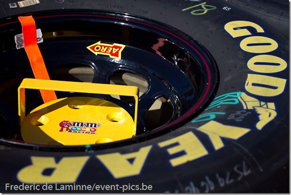 A m&m sponsored weight is placed on bolts of Kyle Busch's wheels before the Goody's Fast Relief 500 at Martinsville