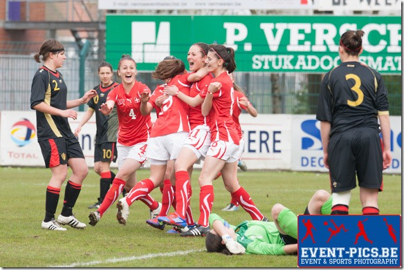 21120413 - HARELBEKE, BELGIUM : Swiss players celebrate their goal while Belgium's goalkeeper Nicky Evrard (1)  lays on the ground during the Second qualifying round of U17 Women Championship between Switzerland and Belgium on Friday April 13th, 2012 in Harelbeke, Belgium.